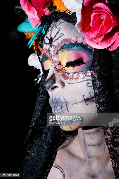 woman dressed as la calavera catrina, traditional mexican female skeleton figure symbolizing death - la catrina stock photos and pictures