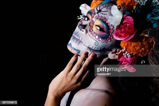 woman dressed as la calavera catrina, traditional mexican female skeleton figure symbolizing death - catrina fotografías e imágenes de stock