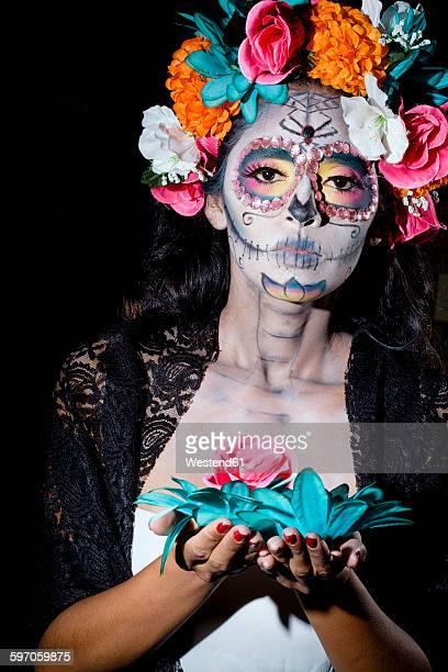 Woman dressed as La Calavera Catrina, Traditional Mexican female skeleton figure symbolizing death