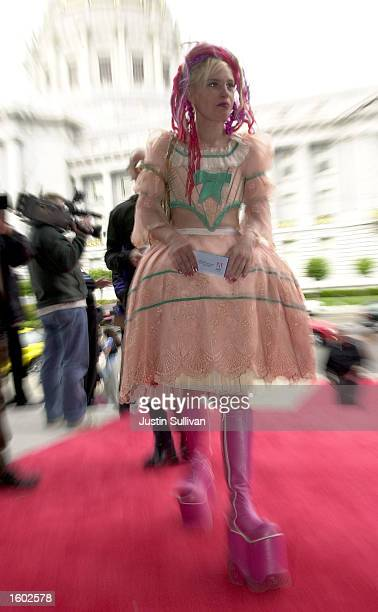 A woman dressed as Little Bo Peep enters the 5th annual Webby Awards held at the War Memorial Opera House July 18 2001 in San Francisco The Webby''s...