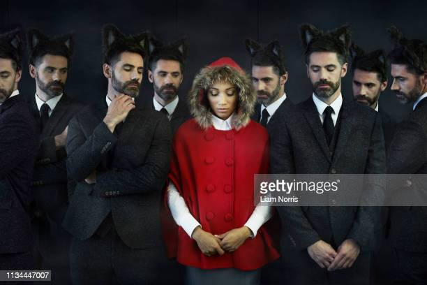 woman dressed as little red riding hood with businessmen, multiple image - stereotypical stock pictures, royalty-free photos & images
