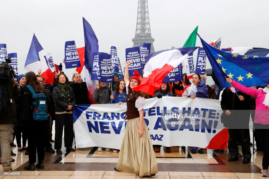 A Woman Dressed As Marianne A National Symbol Of The French