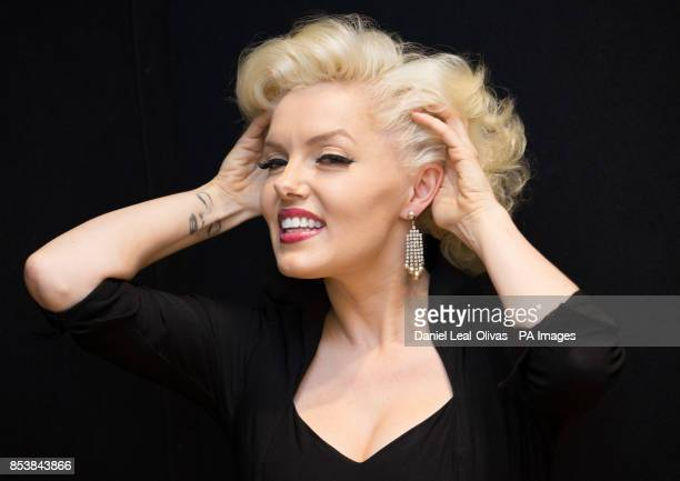 A woman dressed as Marilyn Monroe wearing earrings worn by Marilyn Monroe in the film How to Marry a Millionaire which are part of the Famous and...