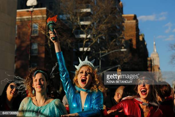 TOPSHOT A woman dressed as Statue of Liberty reacts as she takes part duringan International Women's Strike Rally in Washington square park on March...