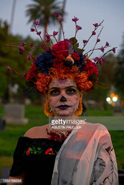 A woman dressed as the Catrina the Mexican traditional representation of death poses at Hollywood Forever Cemetery's 19th annual Dia De Los Muertos...