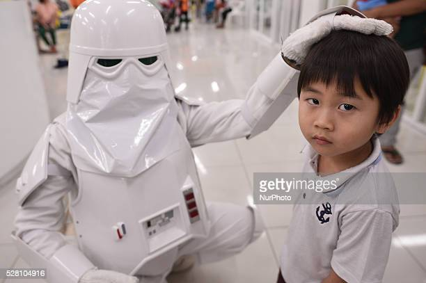 A woman dressed as the character Snowtrooper from a famous movie Star Wars plays with a man during the Star Wars day in Bangkok Thailand on May 4 2016