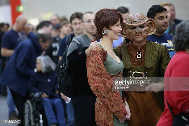 A woman dressed as the Star Trek character 'Leeta' and man dressed as 'Rom' arrive to attend the 'Destination Star Trek London' convention at the...