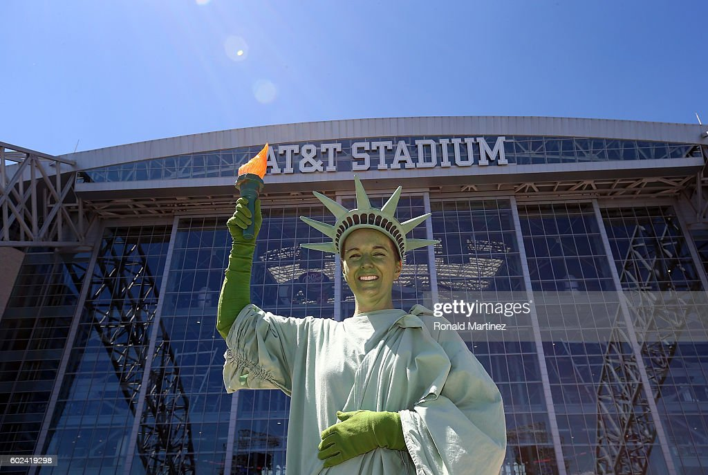 A woman dressed as the Statue of Liberty before a game between the New York Giants and the Dallas Cowboys at AT&T Stadium on September 11, 2016 in Arlington, Texas.
