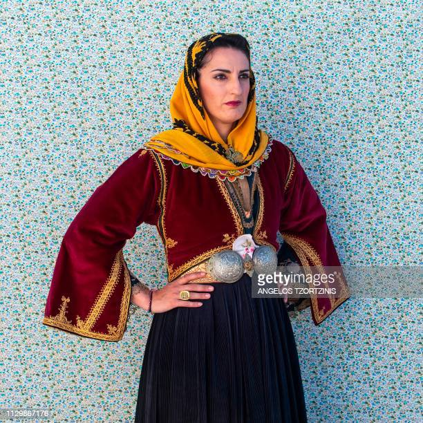 A woman dressed in a ''Koumiotisa'' costume poses for a portrait during the Skyrian Carnival on the island of Skyros northeast of Athens on March 10...