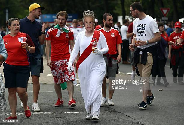 Woman dressed in a Queen Elizabeth mask arrives at the stadium ahead of the England v Wales Euro 2016 Group B match on June 16, 2016 in Lens, France....