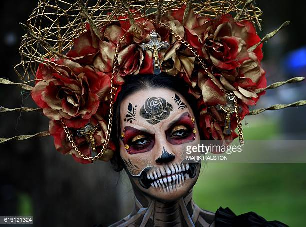 A woman dressed in a skeleton costume parades during the annual Dia de los Muertos festival at the Hollywood Forever cemetery in Hollywood California...