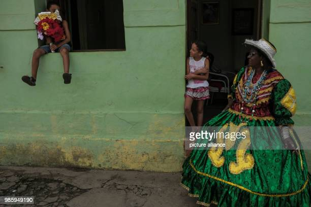 A woman dressed in a traditional Maracatu costume waits for his group to attend the carnival parade in Nazare de Mata Brazil 13 February 2018 Nazare...