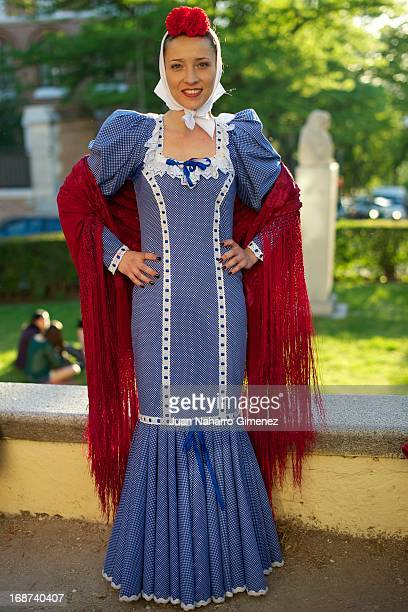 A woman dressed in chulapo looks on during the festivities on May 14 2013 in Madrid Spain These festivities are in honor of San Isidro Labrador and...