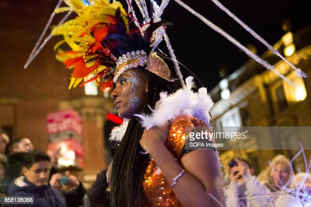 A woman dressed in colourful costume is pictured as she walks though the street during the Leeds Festival Light Night Leeds is an annual free...