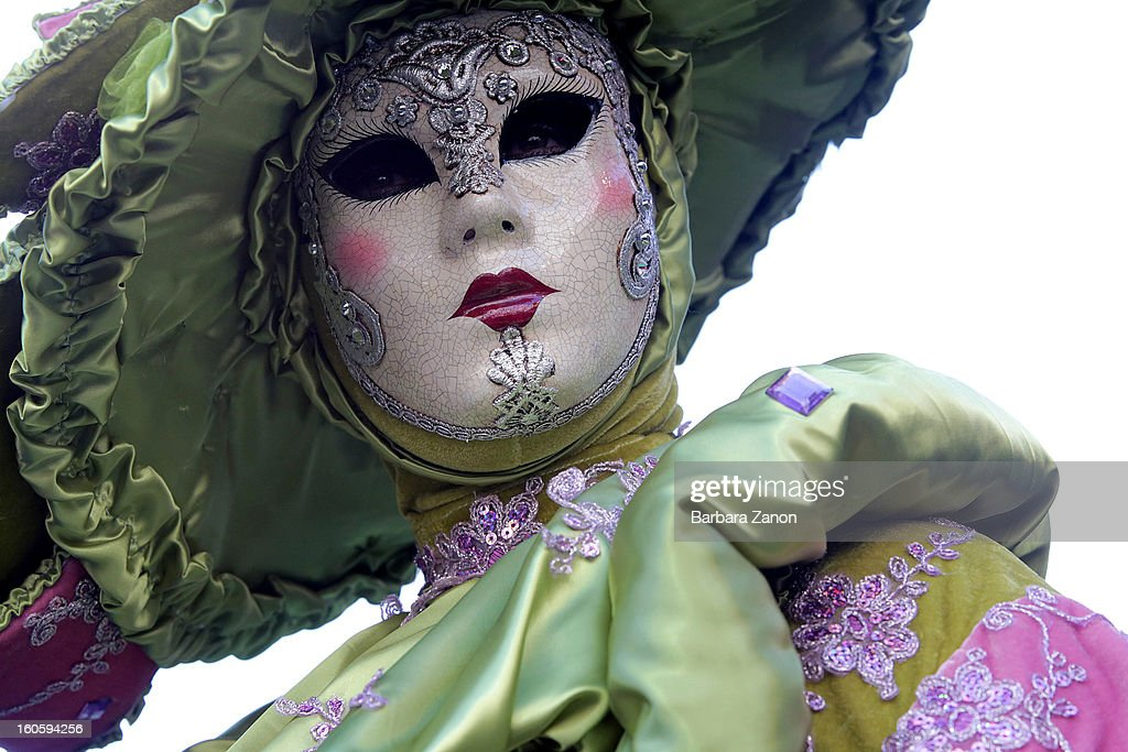 A woman dressed in costume performs on stage during the Volo dell'Angelo at the official Opening of Venice Carnival at Piazza San Marco on February 3, 2013 in Venice, Italy. The Carnival which starts on February 2 and finishes on February 12, attracts thousands of tourists from all over the world.