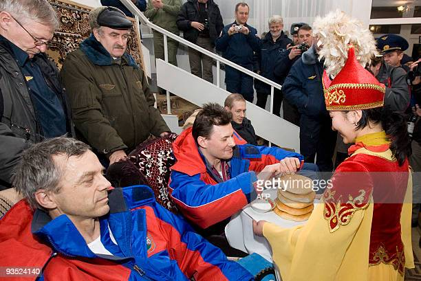 A woman dressed in Kazakh national costume welcomes the International Space Station crew European Space Agency astronaut Frank De Winne of Belgium...
