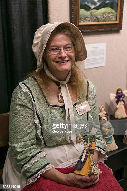 A woman dressed in oldfashioned clothing is viewed at The Craft Fair of the Southern Highlands on October 22 2016 in Asheville North Carolina Named...
