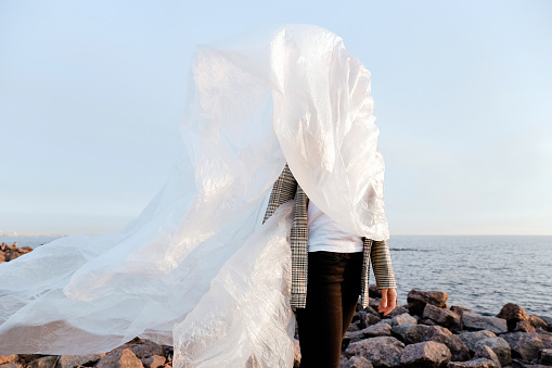 Woman dressed in plastic for the sea - gettyimageskorea
