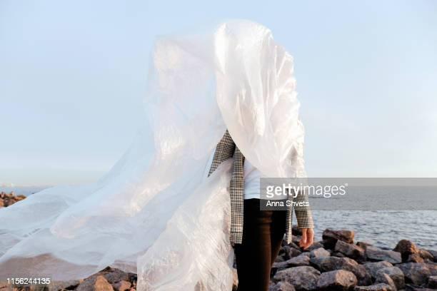 woman dressed in plastic for the sea - fashion show foto e immagini stock