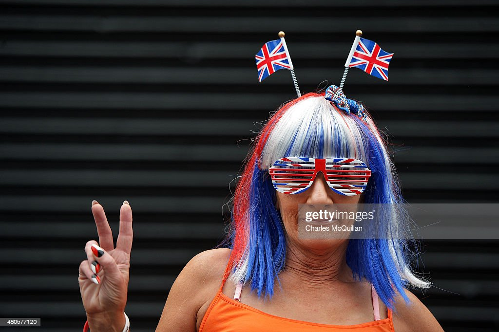 A woman dressed in red, white and blue watches the main Orange demonstration during the Twelfth of July parade on July 13, 2015 in Belfast, Northern Ireland. The Twelfth is an Ulster Protestant celebration held annually. It celebrates the victory of Protestant king William of Orange over Catholic king James II at the Battle of the Boyne in 1690. This year the Twelfth takes place on the thirteenth of July due to the original date falling on a Sunday.