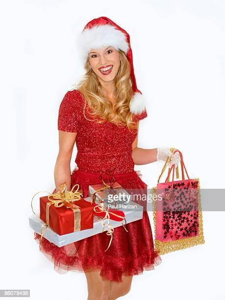 woman dressed in santa costume - weihnachtsfrau stock-fotos und bilder
