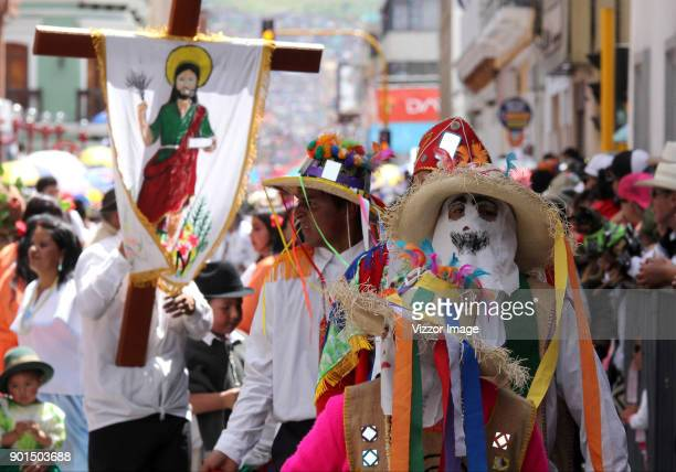 A woman dressed in the traditional costumes participates in the Castañeda family parade as part of the Blacks and Whites' Carnival on January 04 2018...