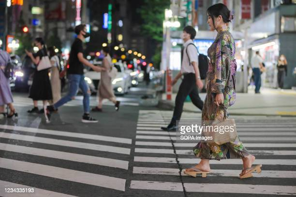 Woman dressed in Yukata walks towards Kabukicho, the biggest entertainment district in Tokyo. 3300 people have tested positive for the Novel...