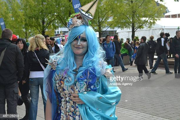 A woman dressed up as a Japanese cartoon character is seen on the last day of Frankfurt Book Fair 2014 in Frankfurt Germany on October 12 2014