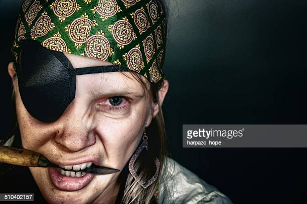 Woman dressed up as a pirate.