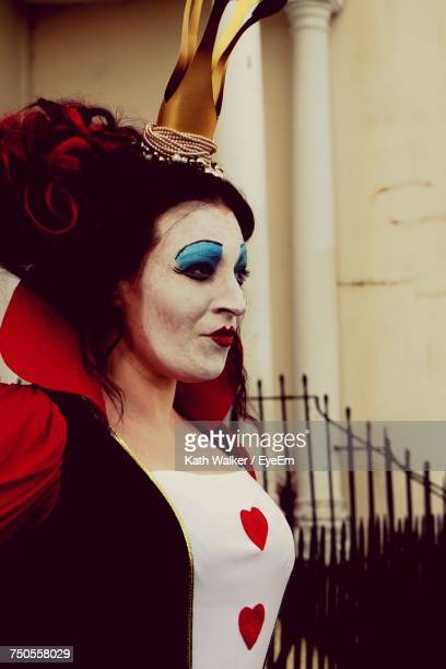 woman dressed up as queen of hearts - queen of hearts stock photos and pictures