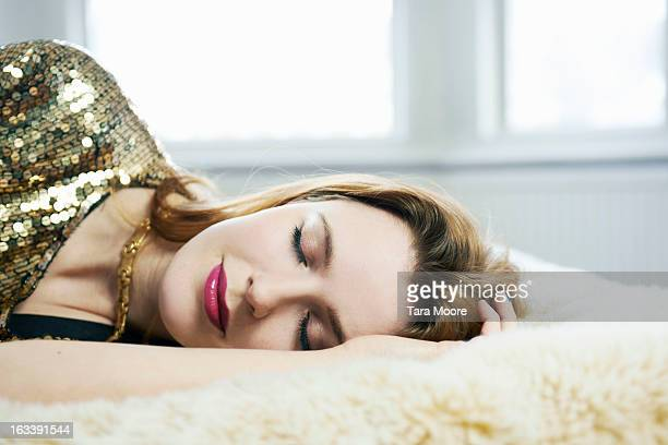 woman dressed up asleep on bed - beautiful woman stock pictures, royalty-free photos & images