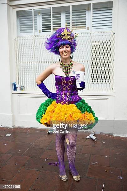 woman dressed up on fat tuesday in new orleans - mardi gras fun in new orleans stock photos and pictures