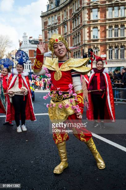 A woman dressed with traditional Chinese costume seen on the Chinatown streets during the Chinese New Year celebration Chinese London community...
