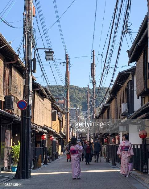woman dressing in traditional japanese clothing and taking picture at gion area, kyoto, japan - vsojoy stock pictures, royalty-free photos & images