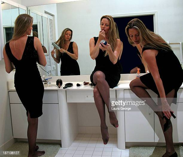 woman dressing up in dressing room - black dress with stockings foto e immagini stock