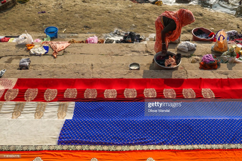 A Woman Dries Clothes In Varanasi Ghats : Stock Photo