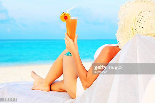 Woman drink cocktail on the beach