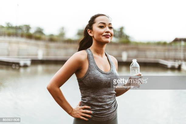 woman drink water after the training - bra top stock pictures, royalty-free photos & images