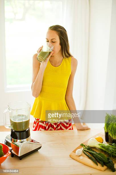 Woman drinking a healthy smoothie