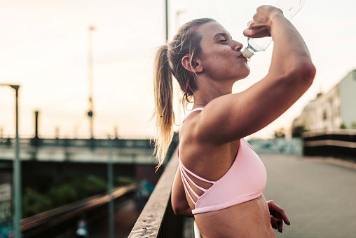 Woman drinking after hard workout. - gettyimageskorea
