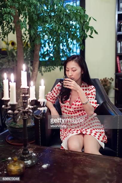woman drinking alone