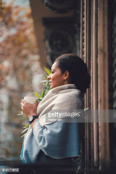 woman drinking coffee at the terrace - mindfulness stock pictures, royalty-free photos & images