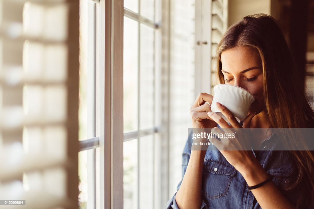 Woman drinking coffee early in the morning : Stock Photo