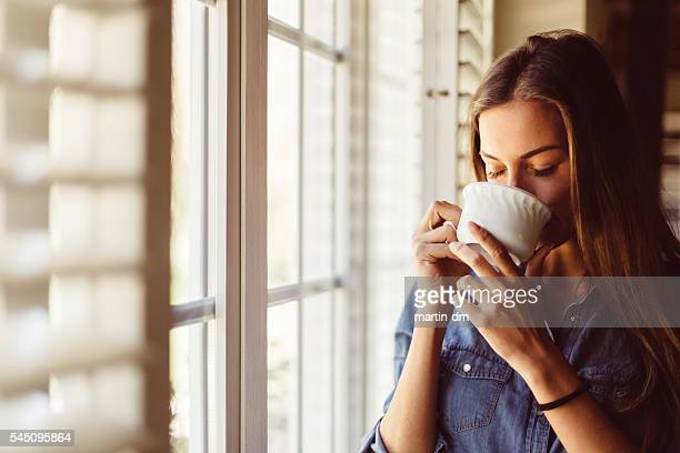 Woman drinking coffee early in the morning