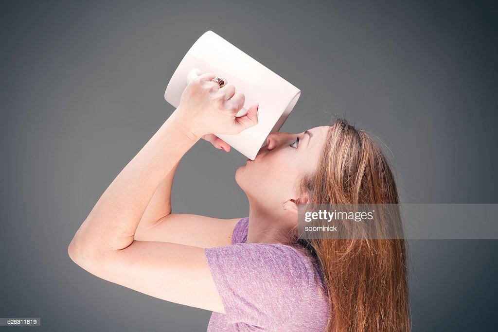 Woman Drinking Coffee From Very Large Mug : Stock Photo