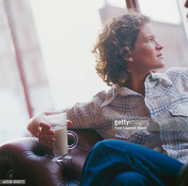 woman drinking coffee in cafe - heidi coppock beard stock-fotos und bilder