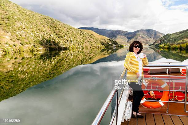 Woman drinking coffee on a river cruise