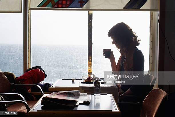 woman drinking coffee on ferry. - ferry stock pictures, royalty-free photos & images