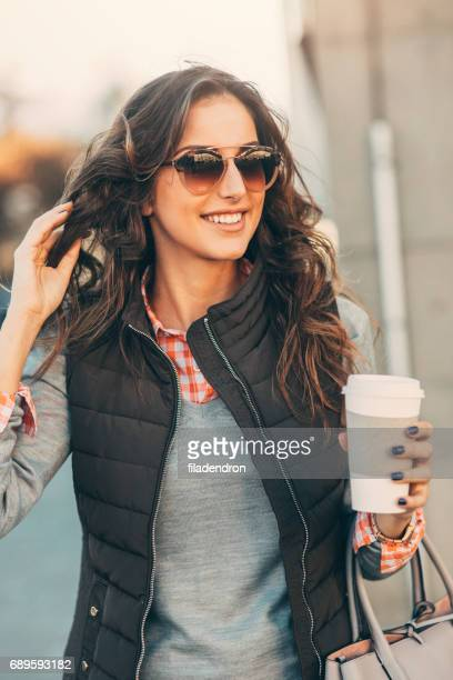 woman drinking coffee outdoors. - one young woman only stock pictures, royalty-free photos & images