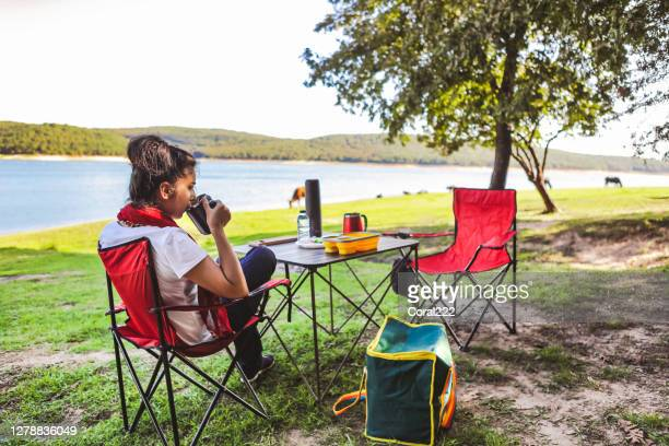 woman drinking coffee - foldable stock pictures, royalty-free photos & images